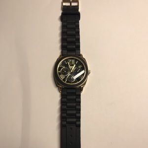 Geneva black and gold women's watch